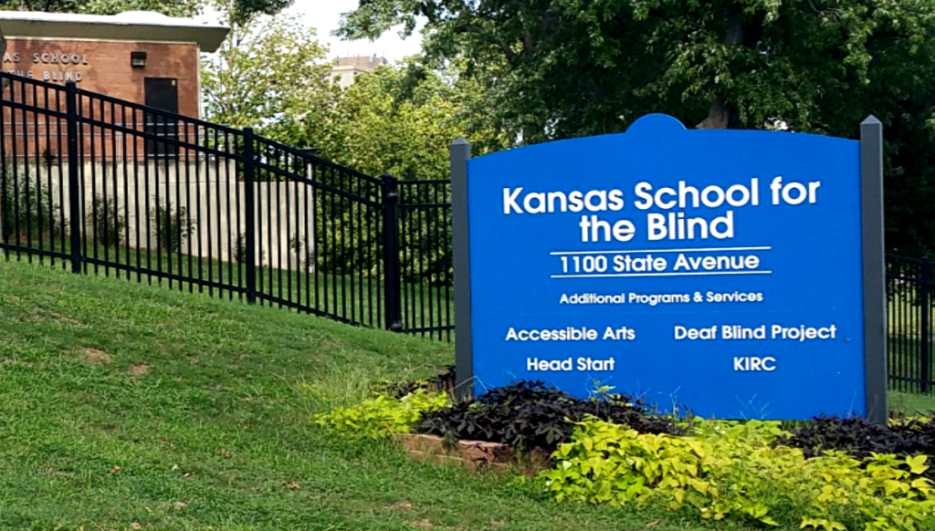 KSSB entrance Sign listing name, address, accessible arts, deaf blind project, Head Start and KIRC.