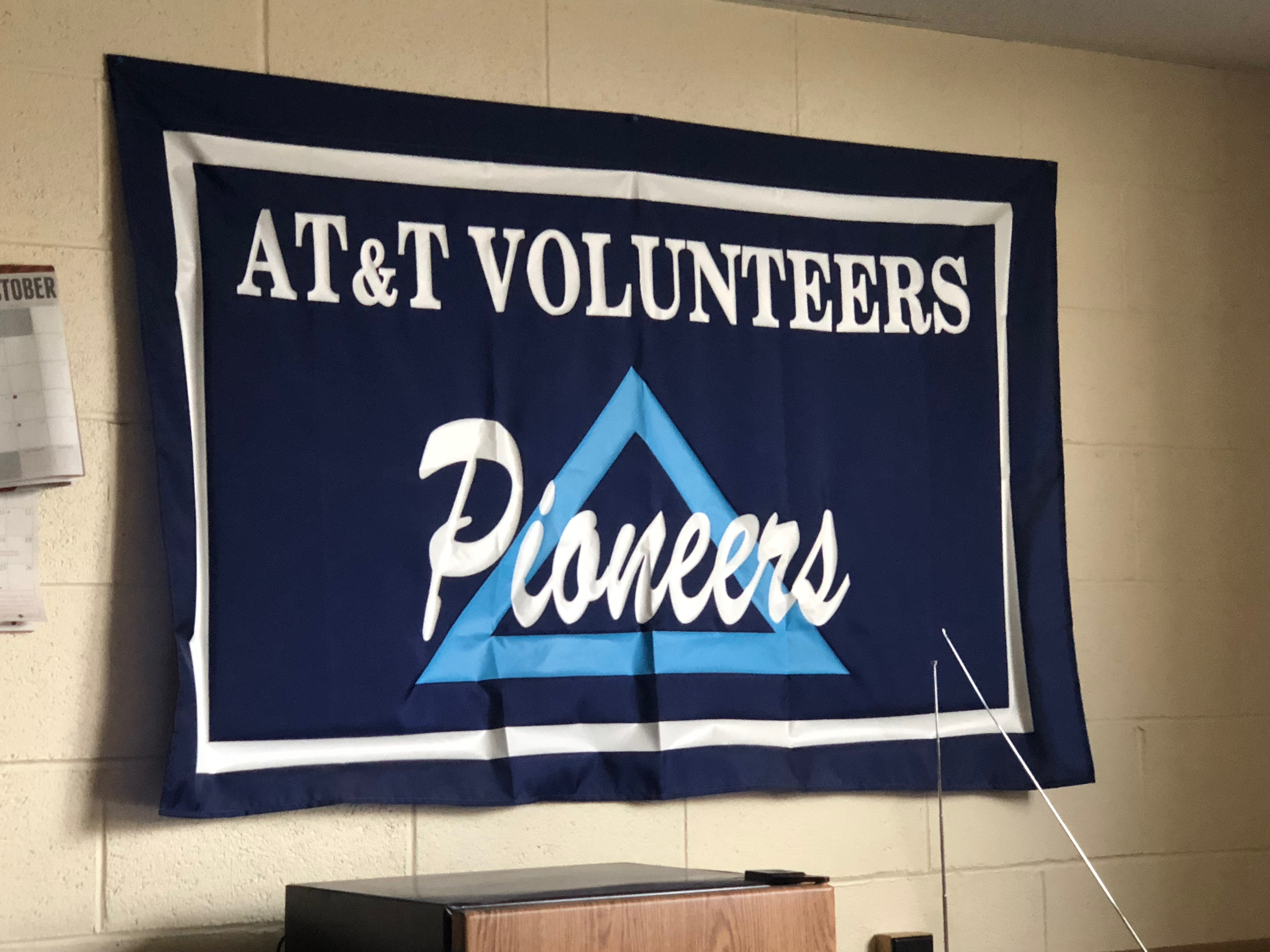 Cloth Sign with embroidery of: AT&T Volunteers Pioneers.