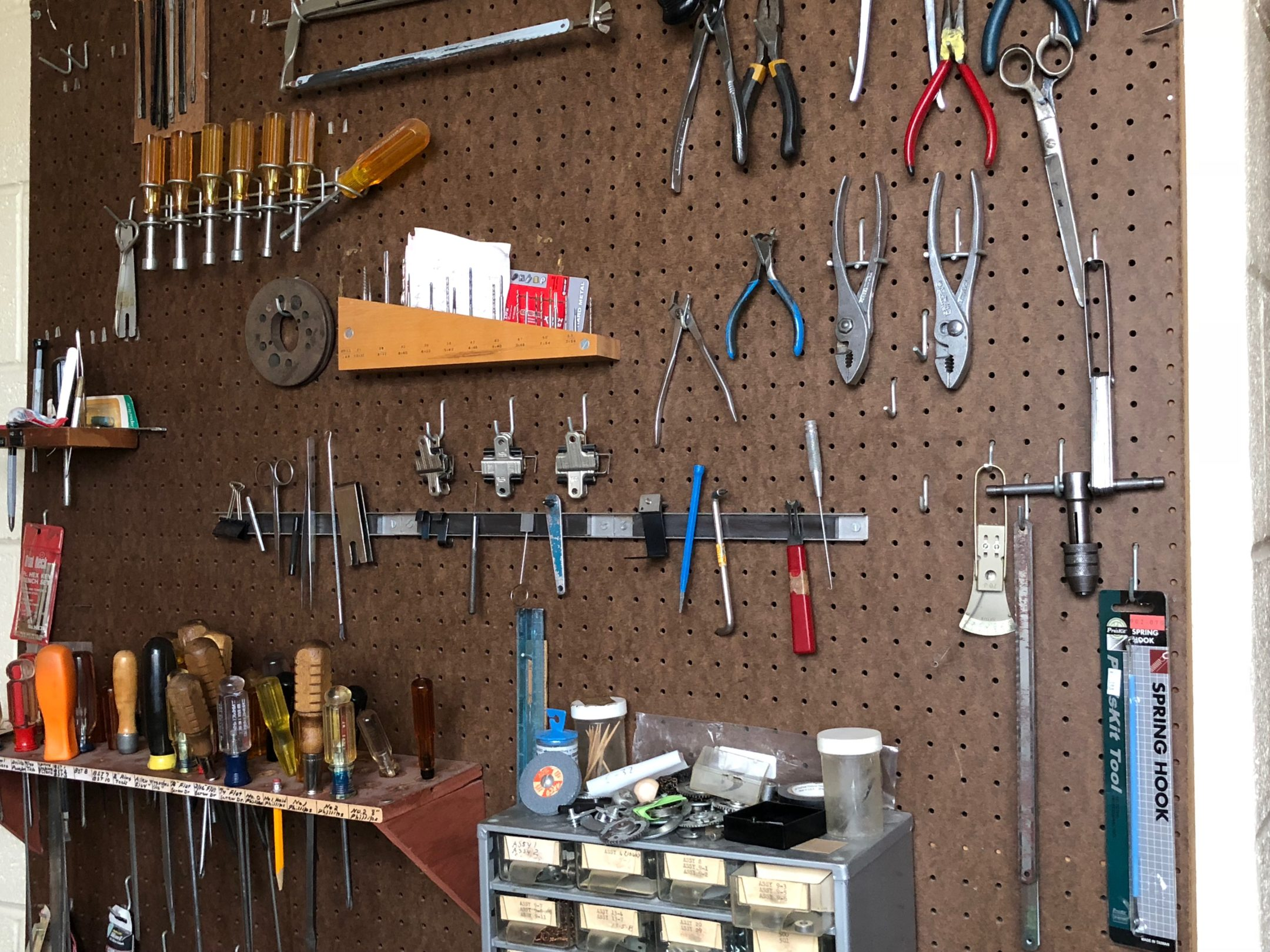 A pegboard of tools used to repair the braille writers.