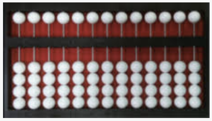 A Cranmer Abacus set to zero with black frame, red felt behind the white beads.