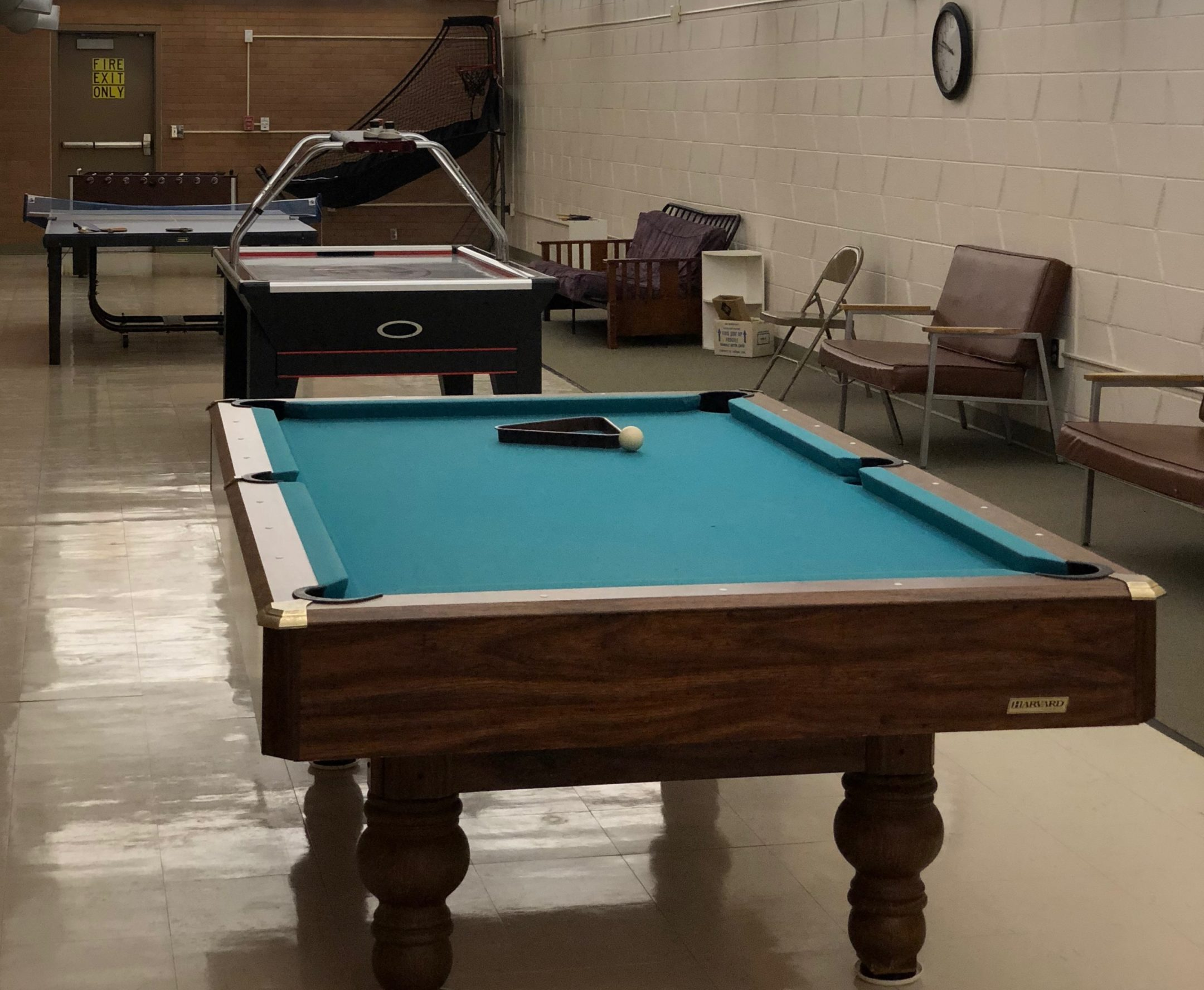The recreation room with a pool table and air hockey table.