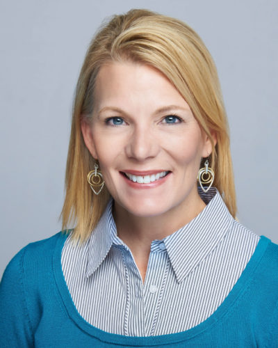 Debbie Moody wearing a blue collared shirt.
