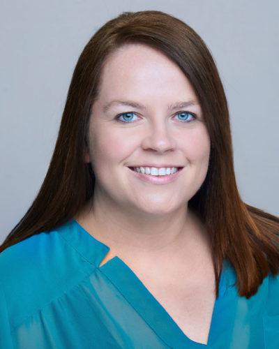 Sabrina McAdoo wearing a green v-necked shirt.