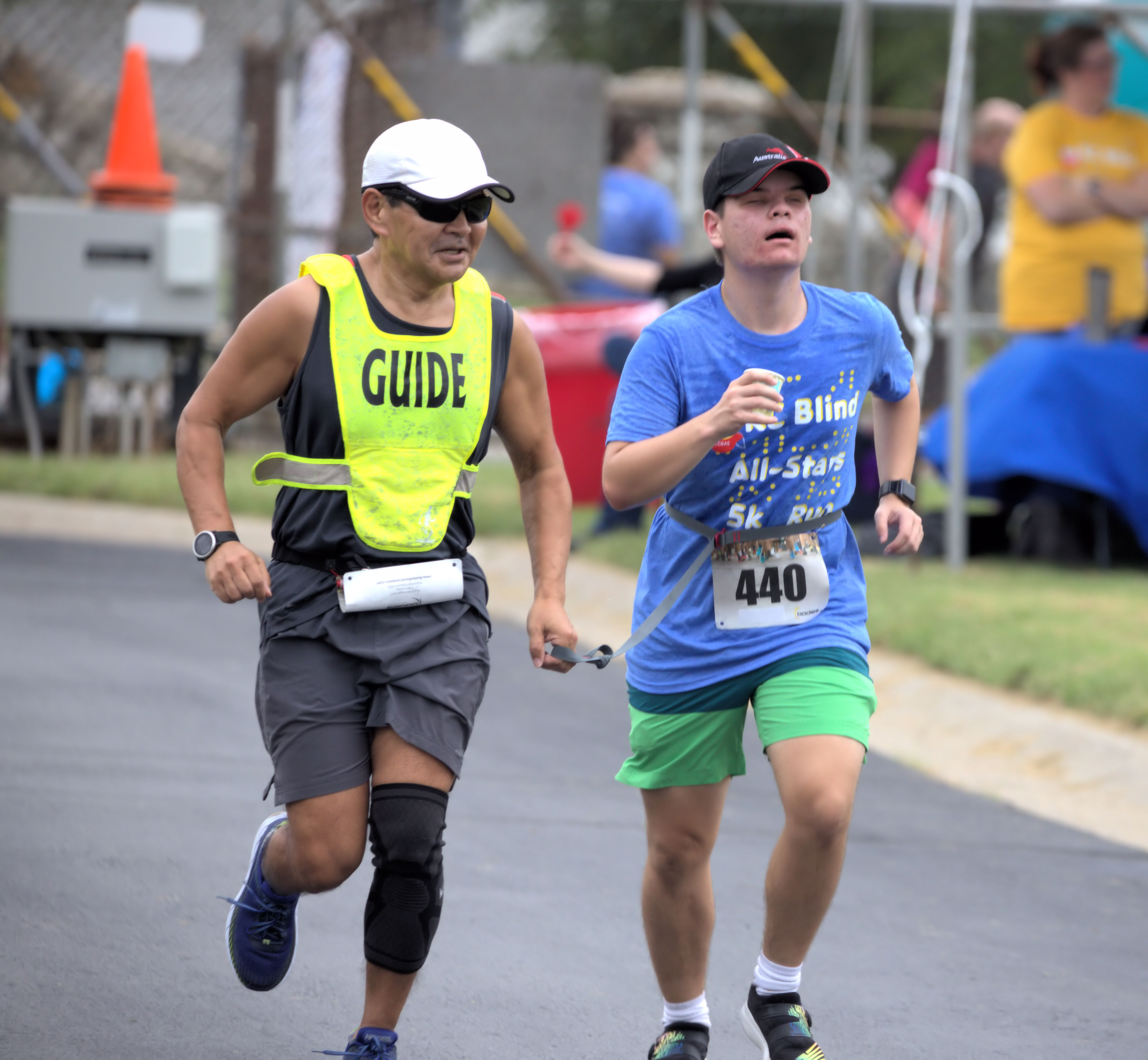 A student and guide runner at the finish line.