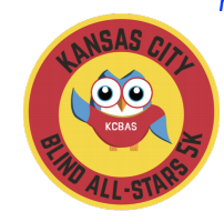 Layered Circle. In Yellow Center A Cartoon Owl With Big Eyes And Waving One Wing. He Is Wearing A Red Shirt With KCBAS On Front. The Surrounding Red Ring Is Labeled Kansas City Blind All-Stars 5K