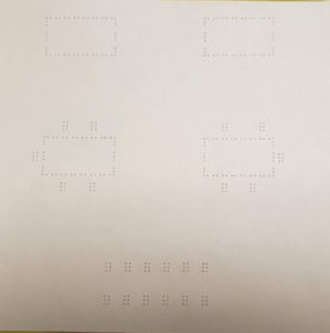A braille map of table and chair set-up for an event.