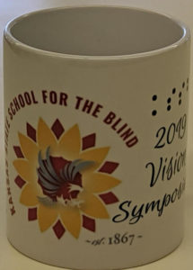 Mug with Kansas School for the Blind and 2019 Vision Symposium and the KSSB sunflower logo imprinted.