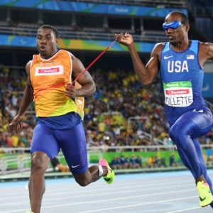 Lex Gillette Running With His Guide In The Olympics
